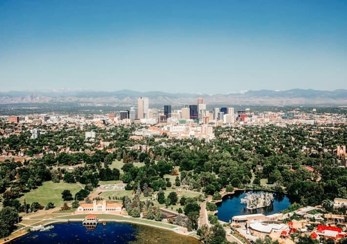 Skyline of Denver, Colorado with the Rocky Mountain Range in the background. This urban oasis and nature filled beauty has many things to do.